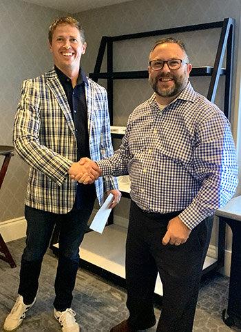 John Duda awarding RISE Coin to SummitET associate